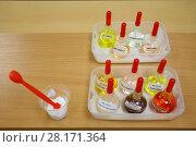 Купить «Test tubes with solutions on table, glass with cream and spatula, Text translation - sea buckthorn oil, almond oil, green tea extract, oatmeal extract, vitamin A, E, F, B5», фото № 28171364, снято 15 сентября 2016 г. (c) Losevsky Pavel / Фотобанк Лори