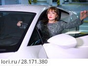 Купить «Beautiful woman sits in modern sport car with opened door and looks away in parking», фото № 28171380, снято 20 мая 2016 г. (c) Losevsky Pavel / Фотобанк Лори