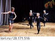 Купить «MOSCOW, RUSSIA - MAY 21, 2016: Young girls rehearse with coach on stage of dance studio Firebird in Bogorodskoe», фото № 28171516, снято 21 мая 2016 г. (c) Losevsky Pavel / Фотобанк Лори