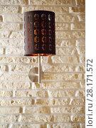 Купить «Brown wall bracket lamp are on white brick wall, close up view», фото № 28171572, снято 16 апреля 2016 г. (c) Losevsky Pavel / Фотобанк Лори