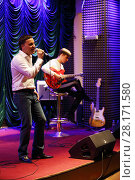 Купить «MOSCOW - APR, 16, 2016: Yugorsky Alexander sings in jazz club Kino», фото № 28171580, снято 16 апреля 2016 г. (c) Losevsky Pavel / Фотобанк Лори