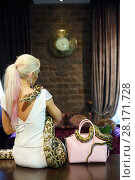 Купить «Blonde slim woman in white sits with two snakes on table, back view, focus on bag with snake», фото № 28171728, снято 18 июля 2016 г. (c) Losevsky Pavel / Фотобанк Лори