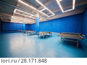Купить «Room with tables for table tennis», фото № 28171848, снято 13 января 2016 г. (c) Losevsky Pavel / Фотобанк Лори