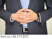 Купить «Hands of man in suit poses with folded hands and wristwatch in studio, noface», фото № 28171872, снято 28 апреля 2016 г. (c) Losevsky Pavel / Фотобанк Лори