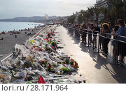 Купить «NICE, FRANCE - JUL 24, 2016: Flowers on quay after terrorist attack July 14, 2016, 86 people were killed under wheels of truck», фото № 28171964, снято 24 июля 2016 г. (c) Losevsky Pavel / Фотобанк Лори