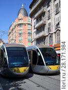 Купить «NICE, FRANCE - JUL 25, 2016: Modern trams at summer sunny day», фото № 28171984, снято 25 июля 2016 г. (c) Losevsky Pavel / Фотобанк Лори