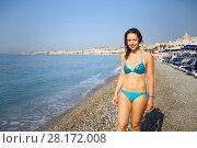 Купить «Woman in blue swimsuit is on pebble beach along coastline at summer day», фото № 28172008, снято 26 июля 2016 г. (c) Losevsky Pavel / Фотобанк Лори
