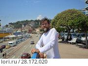 Купить «Man with beard and phone poses in port on Nice, France at sunny day», фото № 28172020, снято 26 июля 2016 г. (c) Losevsky Pavel / Фотобанк Лори