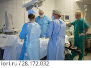 Купить «RUSSIA, MOSCOW - 01 SEP, 2015: Doctor with assistants are removing tumor in the center of endosurgery and lithotripsy», фото № 28172032, снято 1 сентября 2015 г. (c) Losevsky Pavel / Фотобанк Лори