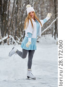 Купить «Young woman in blue knitted dress, white fur mantle and hat at outdoor skate rink on skates in winter park», фото № 28172060, снято 19 января 2016 г. (c) Losevsky Pavel / Фотобанк Лори