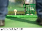 Купить «Man hitting ball for golf during training, focus on ball, shallow dof, noface», фото № 28172160, снято 1 мая 2016 г. (c) Losevsky Pavel / Фотобанк Лори