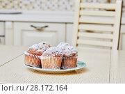 Купить «Closeup five cupcakes on plate on table in kitchen», фото № 28172164, снято 19 января 2016 г. (c) Losevsky Pavel / Фотобанк Лори