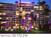 Купить «CANNES, FRANCE - JUL 29, 2016: Building of Grand hotel and park with palm trees in yard on summer evening», фото № 28172216, снято 29 июля 2016 г. (c) Losevsky Pavel / Фотобанк Лори
