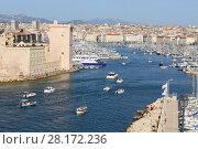 Купить «Boats and yachts moored in old port near Saint Jean Castle in Marseille, France», фото № 28172236, снято 30 июля 2016 г. (c) Losevsky Pavel / Фотобанк Лори