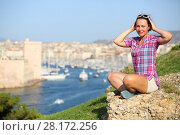 Купить «Smiling woman sits on hill near old port Marseille, France at sunny summer day», фото № 28172256, снято 30 июля 2016 г. (c) Losevsky Pavel / Фотобанк Лори