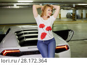 Купить «Young smiling woman poses sitting on trunk of modern white car at underground parking», фото № 28172364, снято 2 июня 2016 г. (c) Losevsky Pavel / Фотобанк Лори