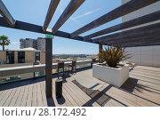 Купить «MONTE CARLO, MONACO - AUG 3, 2016: Place to relax on terrace of one of modern buildings», фото № 28172492, снято 3 августа 2016 г. (c) Losevsky Pavel / Фотобанк Лори