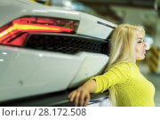 Купить «Young woman in yellow dress sits leaning back onto trunk of modern white car at underground parking», фото № 28172508, снято 2 июня 2016 г. (c) Losevsky Pavel / Фотобанк Лори