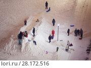 Купить «Children and parents rest near ice slide at evening, aerial view», фото № 28172516, снято 26 января 2016 г. (c) Losevsky Pavel / Фотобанк Лори