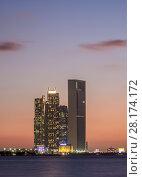 Купить «Skyline with Etihad Towers at sunset, Abu Dhabi, United Arab Emirates.», фото № 28174172, снято 8 января 2018 г. (c) age Fotostock / Фотобанк Лори