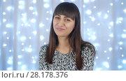 Купить «Portrait of Happy Woman at Christmas», видеоролик № 28178376, снято 26 февраля 2018 г. (c) Илья Шаматура / Фотобанк Лори