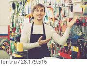 Купить «Professional young salesman working and smiling», фото № 28179516, снято 19 ноября 2018 г. (c) Яков Филимонов / Фотобанк Лори