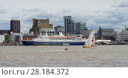 Купить «A yacht passing the Liverpool waterfront just after the start of the 2017 Clipper Round the World Race, with the Marco Polo cruise ship moored at the Pier...», фото № 28184372, снято 4 июля 2020 г. (c) Nature Picture Library / Фотобанк Лори