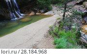 Купить «El Torrent de la Cabana small mountain stream with crystal clear water», видеоролик № 28184968, снято 16 мая 2017 г. (c) Яков Филимонов / Фотобанк Лори