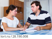 Купить «Serious spouses discussing bills», фото № 28190008, снято 20 марта 2018 г. (c) Яков Филимонов / Фотобанк Лори