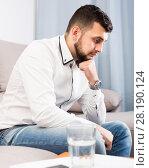 Купить «Sad young male spending day alone», фото № 28190124, снято 5 марта 2017 г. (c) Яков Филимонов / Фотобанк Лори