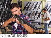 Купить «Man choice pneumatic gun», фото № 28190256, снято 4 июля 2017 г. (c) Яков Филимонов / Фотобанк Лори
