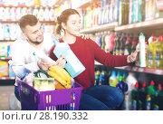 Купить «People buying detergents for house», фото № 28190332, снято 14 марта 2017 г. (c) Яков Филимонов / Фотобанк Лори