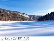 Купить «Winter view of the fjord. Frozen bay with high rocks», фото № 28191100, снято 8 февраля 2014 г. (c) Евгений Ткачёв / Фотобанк Лори