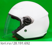 Купить «Open face white motorcycle helmet with attached face shield, side view, green background», фото № 28191692, снято 27 февраля 2018 г. (c) Кекяляйнен Андрей / Фотобанк Лори