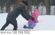 Купить «Together mother with cute little daughter enjoying winter weather in the park», видеоролик № 28192532, снято 24 апреля 2018 г. (c) Константин Шишкин / Фотобанк Лори