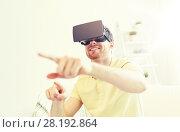 Купить «young man in virtual reality headset or 3d glasses», фото № 28192864, снято 12 марта 2016 г. (c) Syda Productions / Фотобанк Лори