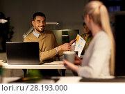 Купить «colleagues discussing project at night office», фото № 28193000, снято 26 ноября 2017 г. (c) Syda Productions / Фотобанк Лори