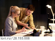 Купить «business team with papers working at night office», фото № 28193008, снято 26 ноября 2017 г. (c) Syda Productions / Фотобанк Лори