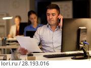 Купить «businessman calling on sartphone at night office», фото № 28193016, снято 6 декабря 2017 г. (c) Syda Productions / Фотобанк Лори