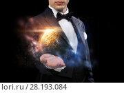 Купить «male magician with planet and space hologram», фото № 28193084, снято 12 сентября 2013 г. (c) Syda Productions / Фотобанк Лори