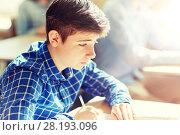 Купить «group of students with books writing school test», фото № 28193096, снято 22 апреля 2016 г. (c) Syda Productions / Фотобанк Лори