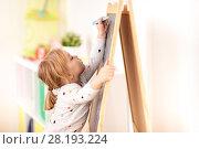 Купить «happy little girl drawing on chalk board at home», фото № 28193224, снято 15 октября 2017 г. (c) Syda Productions / Фотобанк Лори