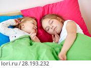 Купить «happy little girls sleeping in bed at home», фото № 28193232, снято 15 октября 2017 г. (c) Syda Productions / Фотобанк Лори