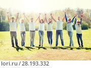Купить «group of volunteers celebrating success in park», фото № 28193332, снято 7 мая 2016 г. (c) Syda Productions / Фотобанк Лори