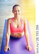 Купить «smiling woman stretching back on mat in gym», фото № 28193356, снято 29 июня 2014 г. (c) Syda Productions / Фотобанк Лори