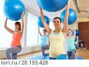Купить «pregnant women training with exercise balls in gym», фото № 28193428, снято 5 марта 2016 г. (c) Syda Productions / Фотобанк Лори