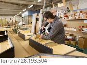 Купить «assembler with screwdriver making furniture», фото № 28193504, снято 10 ноября 2017 г. (c) Syda Productions / Фотобанк Лори