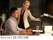 Купить «business team with computer working late at office», фото № 28193548, снято 6 декабря 2017 г. (c) Syda Productions / Фотобанк Лори