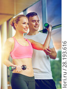 Купить «smiling young woman with personal trainer in gym», фото № 28193616, снято 29 июня 2014 г. (c) Syda Productions / Фотобанк Лори