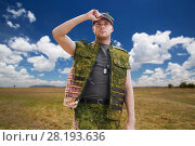 Купить «soldier in military uniform over sky background», фото № 28193636, снято 14 августа 2014 г. (c) Syda Productions / Фотобанк Лори